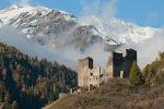 Tschanüff castle, in the background parts of the Piz Spadla mountain, in Switzerland.
