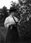 Helen Keller Portrait, holding branch of tree in bloom.